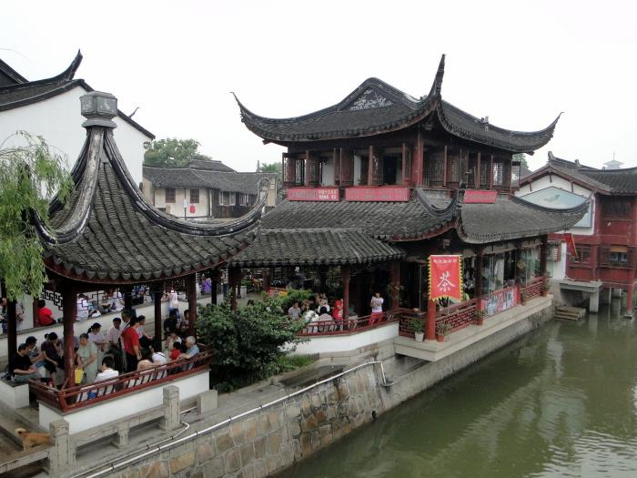 Шанхай, Qi bao